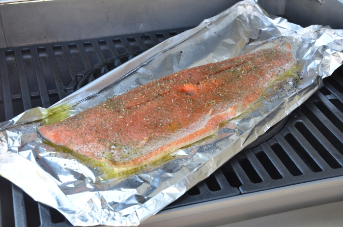 Heat your grill to 350 degrees and season salmon with olive oil, garlic powder, dried dill, sea salt, and pepper.