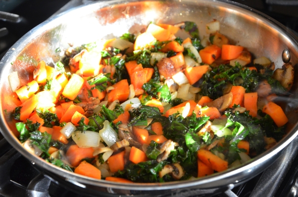 Saute diced sweet potato and onion, sliced mushrooms, and chopped kale in olive oil.