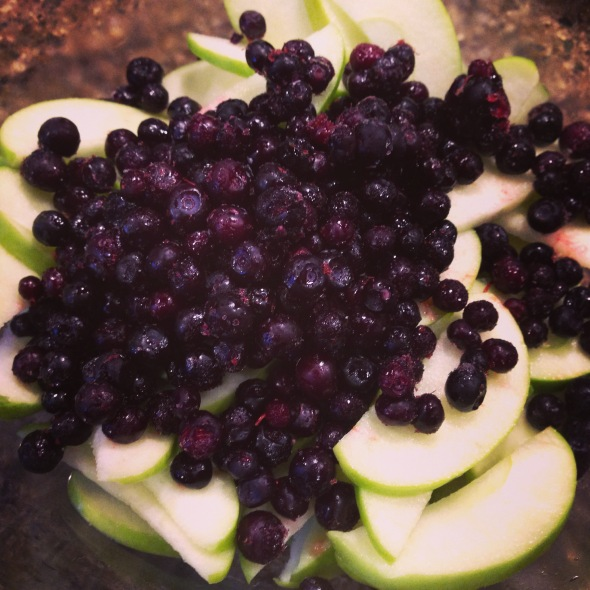 Sliced organic granny smith apples and wild huckleberries.