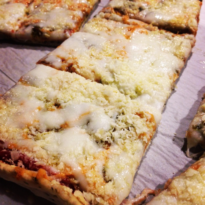 Chebe Foccacia Mix (Paleo), vegan pesto, organic tomato paste, goat mozzarella, and goat parmesan.