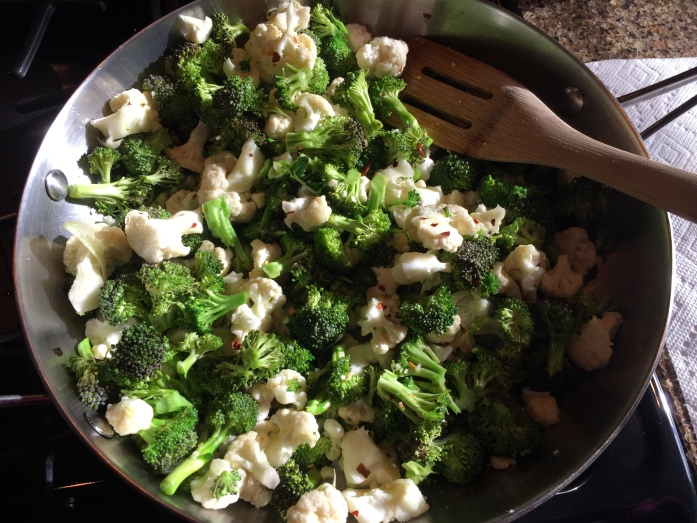 I sauteed my favorite veggie combo, cauliflower and broccoli with olive oil, garlic, and spicy peppers. We just reheated it in the hotel room and it was fantastic.